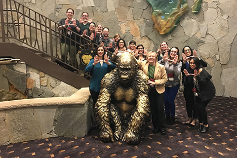 Music Therapy Faculty take a group picture behind a bronze gorilla