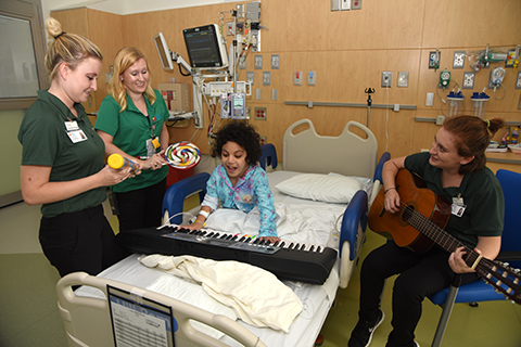 Music Therapy staff interact with patient